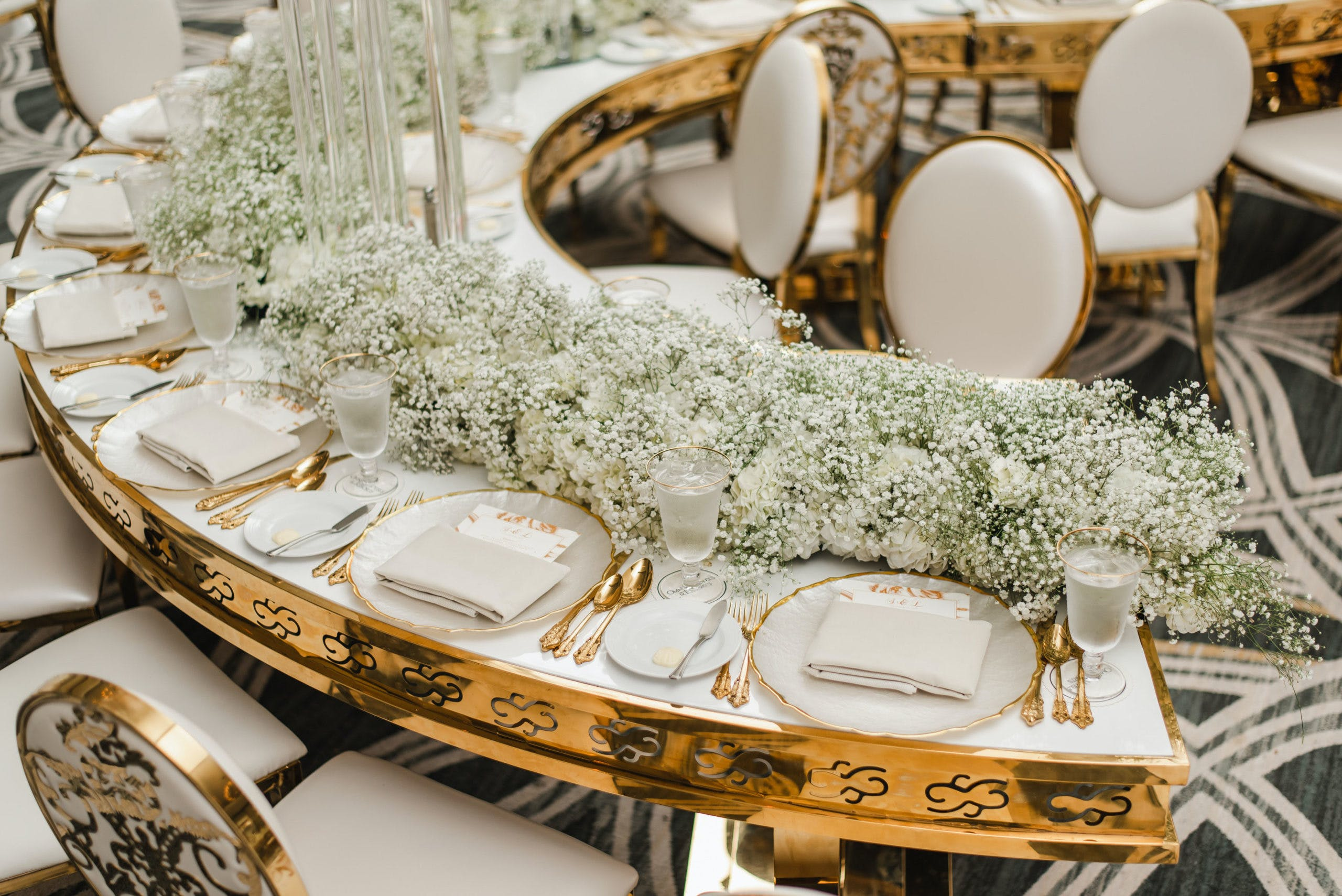 Mod Gold and White Crescent-Shaped Wedding Reception Tables with Baby's Breath Garland Centerpiece   PartySlate