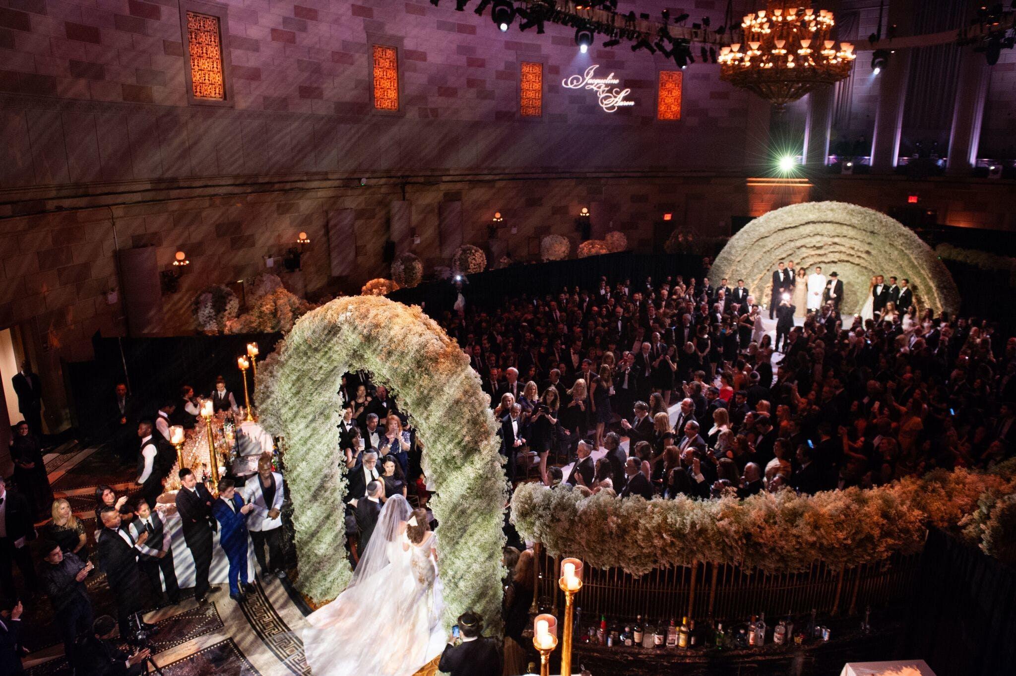 Bride Begins Walk Down the Aisle Through Lavish Baby's Breath Arch   PartySlate