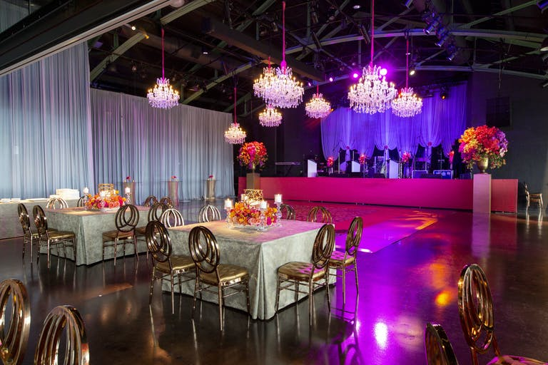 Wedding Reception with Elegant, Industrial-Vibe and Pink Uplighting at Theater on the Lake in Chicago, Illinois   PartySlate