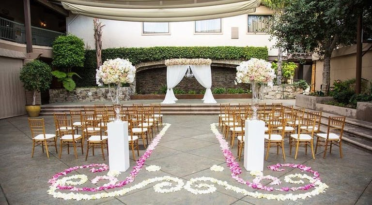 Floral Aisle Decor at DoubleTree by Hilton Hotel Claremont, CA   PartySlate