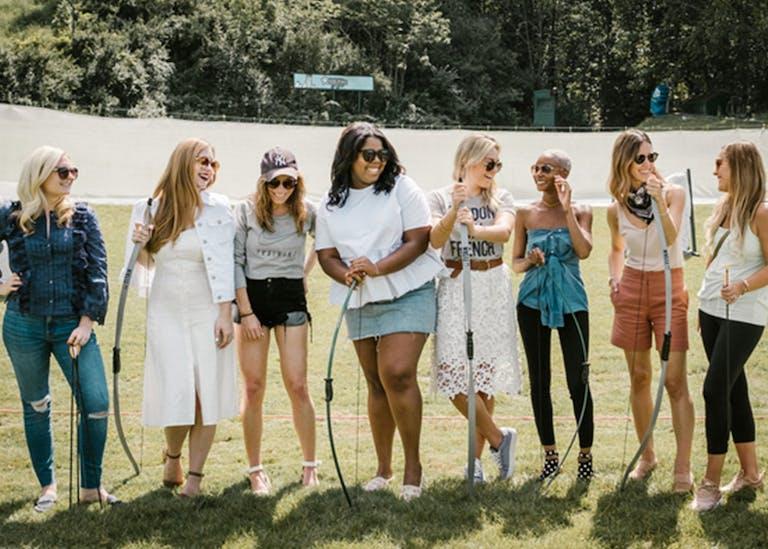 Six Ladies Hold Archery Bows at Grand Geneva Resort & Spa in Lake Geneva, WI   PartySlate