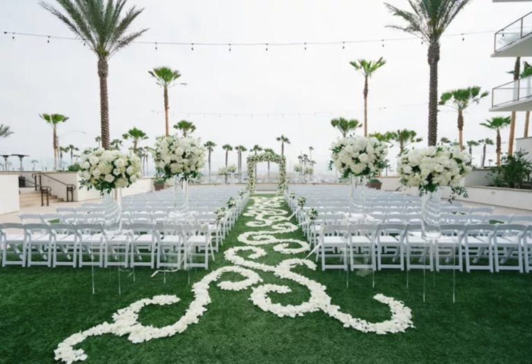 Outdoor Wedding with Floral Aisle Decor in Waterfront Beach Resort Hilton Hotel in Huntington, CA   PartySlate