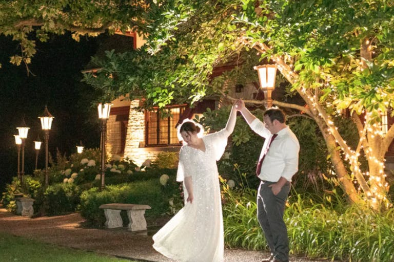 Bride and Groom Dance Outside at The Grove Wedding Venue in Glenview, IL | PartySlate