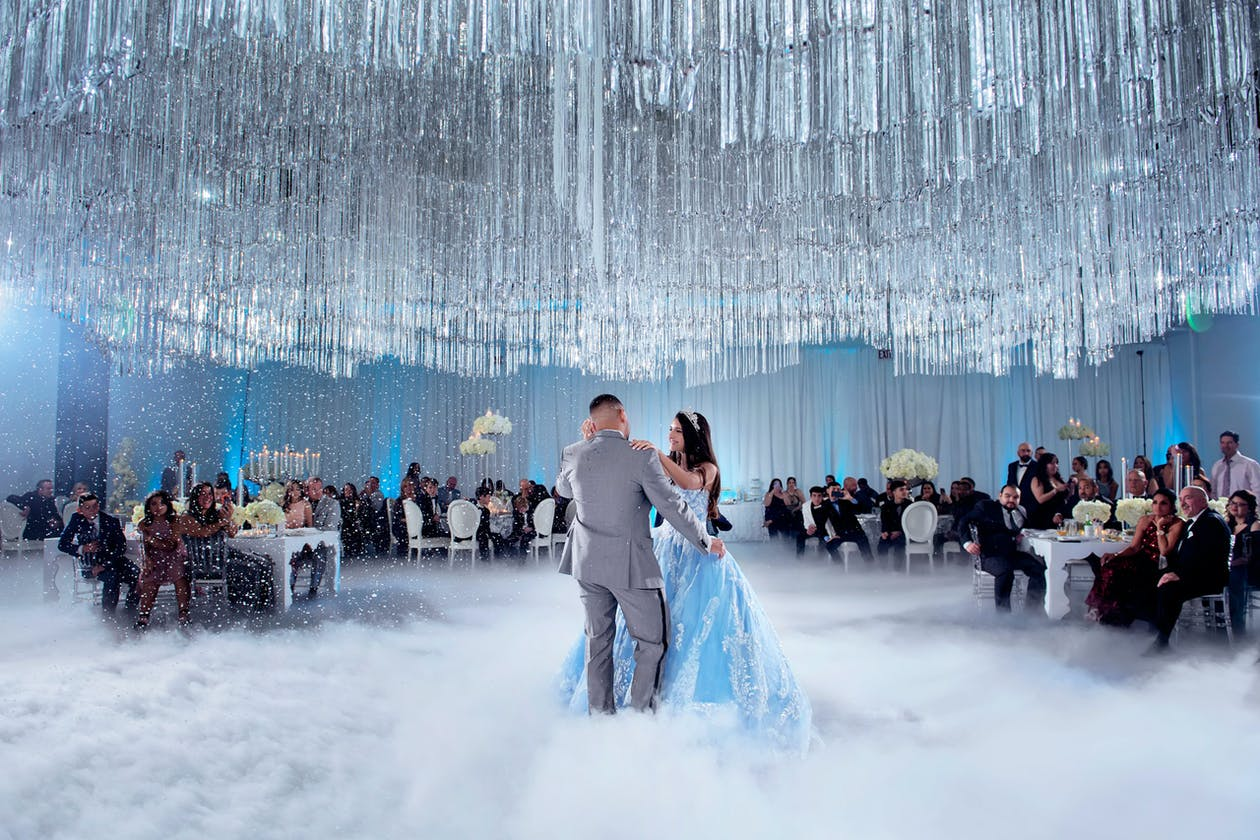 Father and Daughter Dance Through Fog Underneath Crystal Ceiling Installation at Winter Wonderland-Themed Quinceañera celebration
