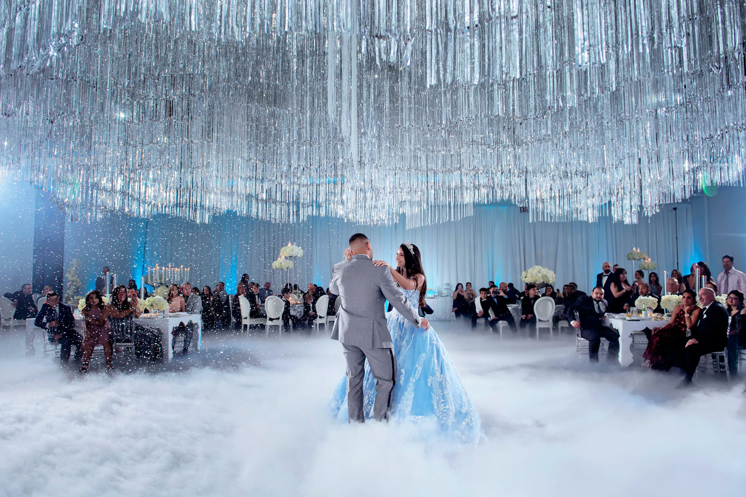 Father and Daughter Dance Through Fog Underneath Crystal Ceiling Installation at Winter Wonderland-Themed Quinceañera | PartySlate