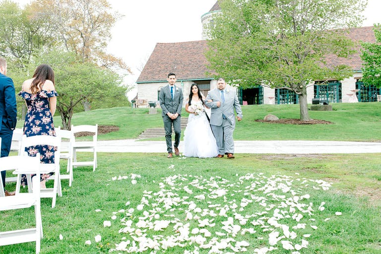 Bride given away at intimate lakeside wedding surrounded with petals at Promontory Point in Chicago, IL   PartySlate