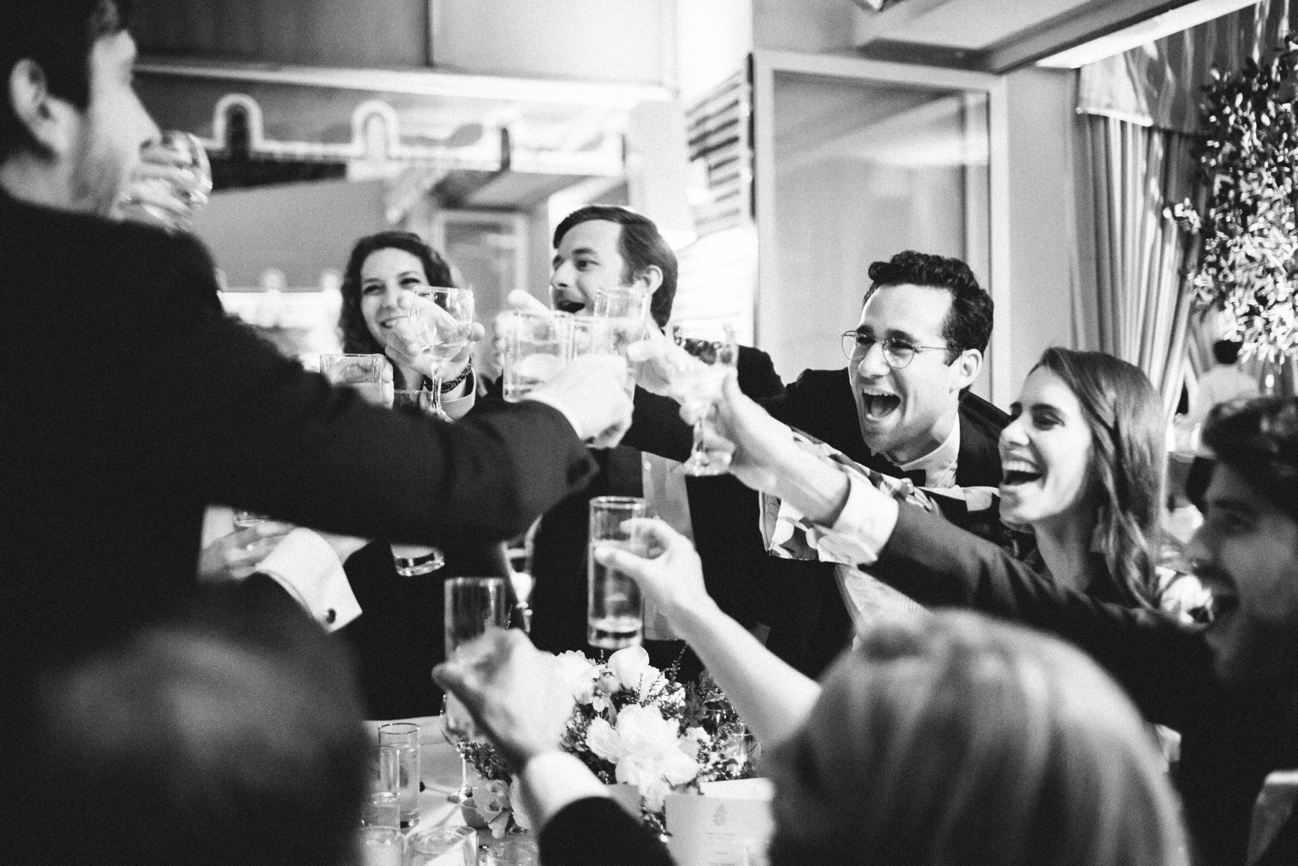Group of people cheersing l PartySlate