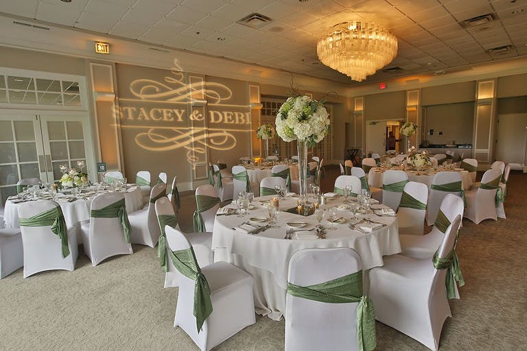 White and pale green wedding with monogrammed lighting at The Grove Country Club in Long Grove, IL | PartySlate