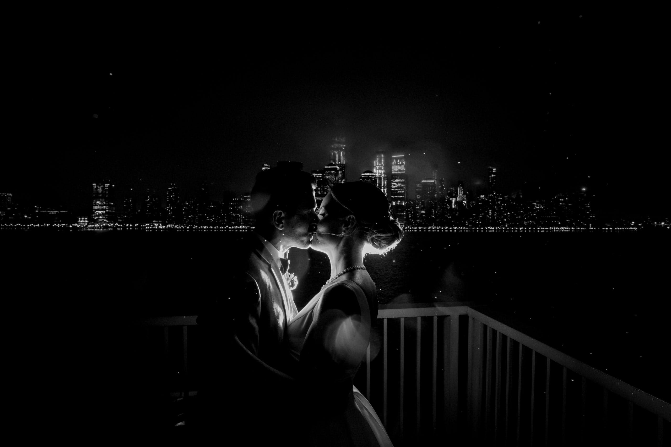 Bride and Groom on a passionate kiss   PartySlate