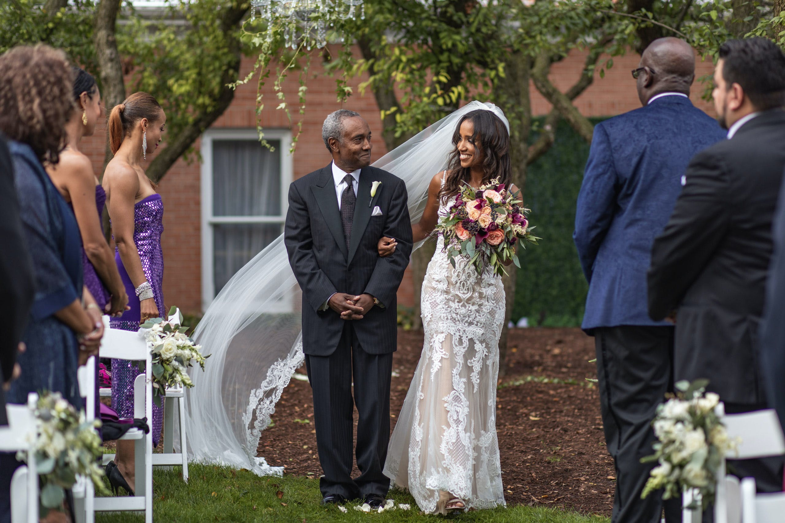 Dad and bride walking down aisle   PartySlate