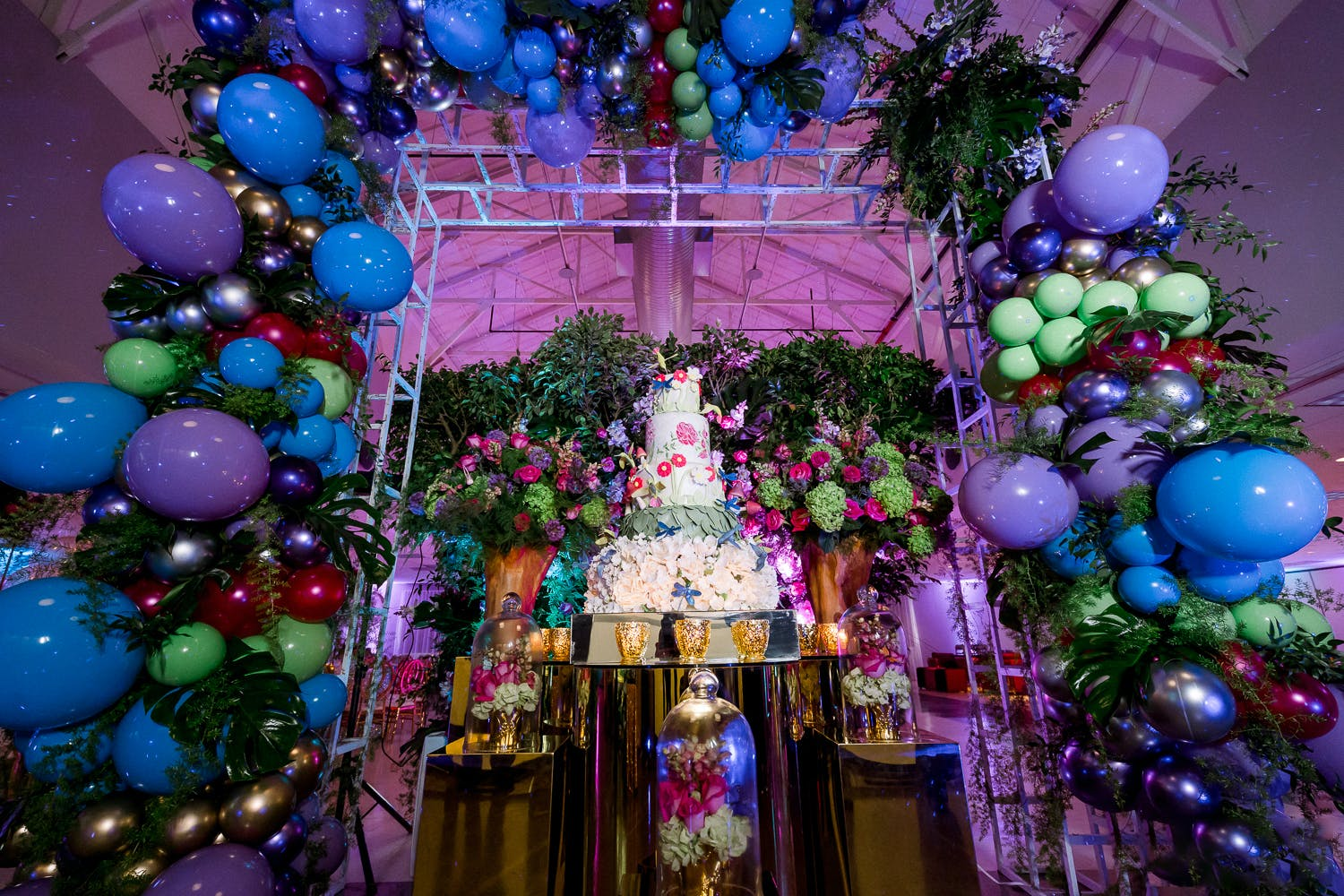 Jewel-Toned Garden Cake and Balloon Arch for Colorful Quinceañera | PartySlate