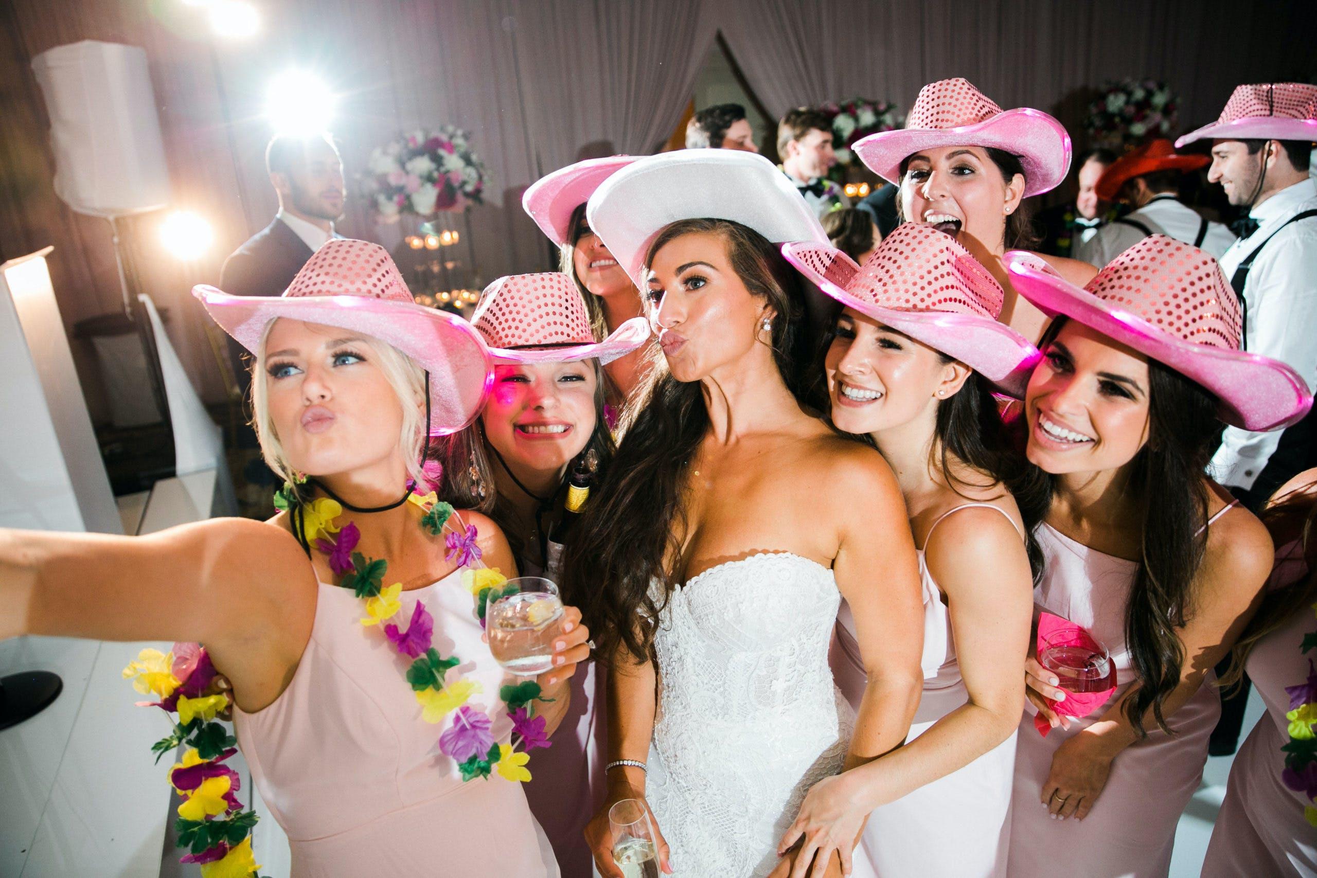 girls take selfie-style photo wearing pink cowboy hats l PartySlate