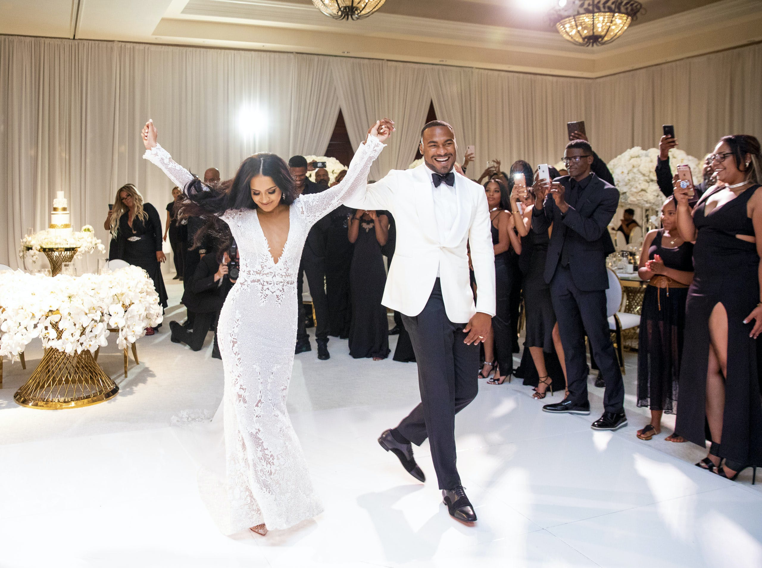 Bride and groom dancing and walking into wedding reception for first time   PartySlate