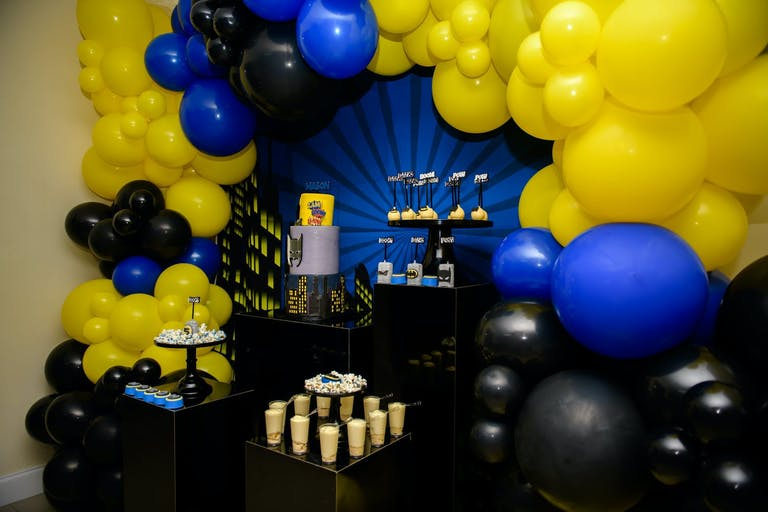 Batman-Themed Kid's Birthday Party With Yellow, Blue, and Black Balloons | PartySlate