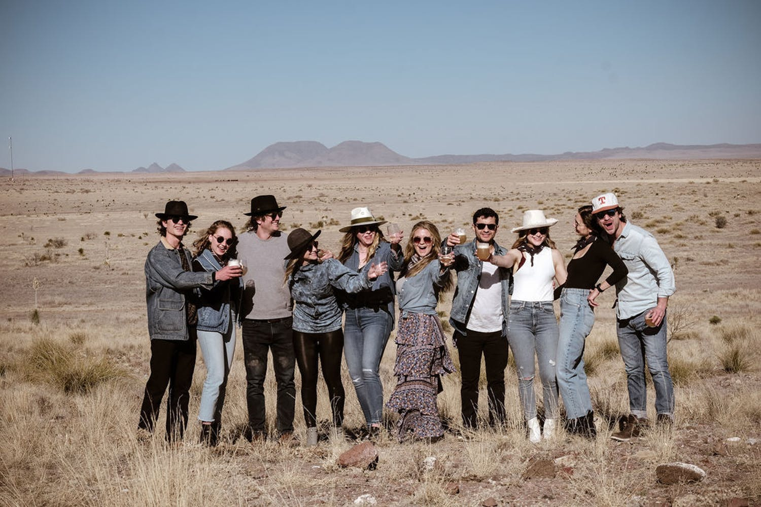 Group of Friends Pose for a Photo Against a Desert Backdrop for a Small Birthday Party | PartySlate