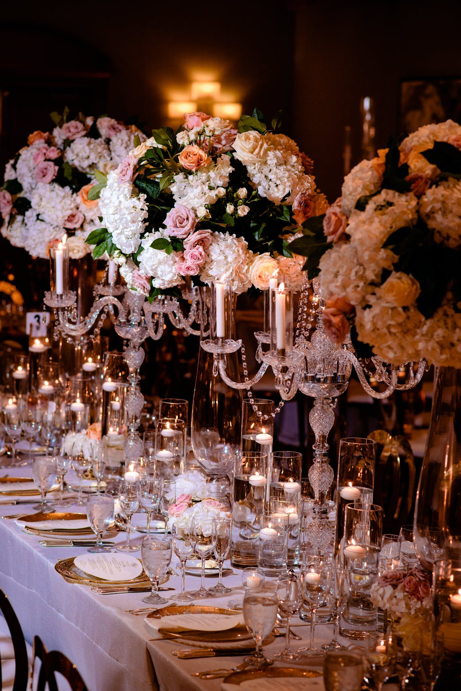 Wedding Tablescape With Pink and White Flowers on Crystal Fringed Candelabras Planned by Doyin Fash Events   PartySlate