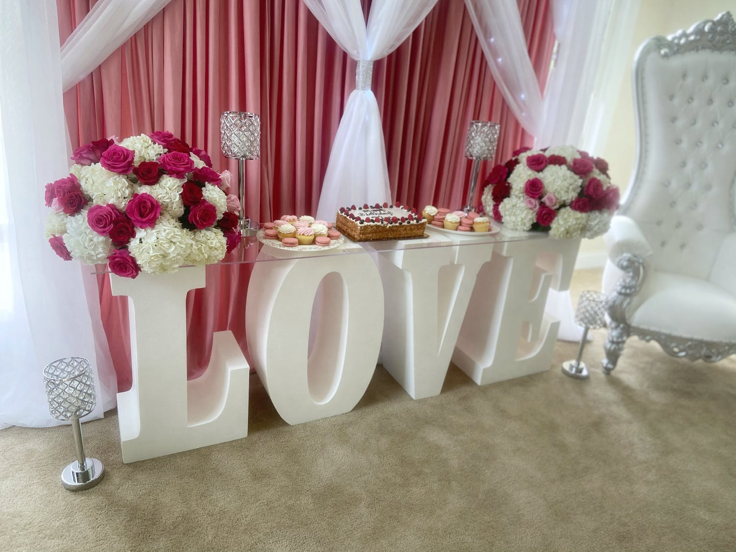 Birthday Dessert Station Laid Out on White Block Letters Spelling Out Love | PartySlate