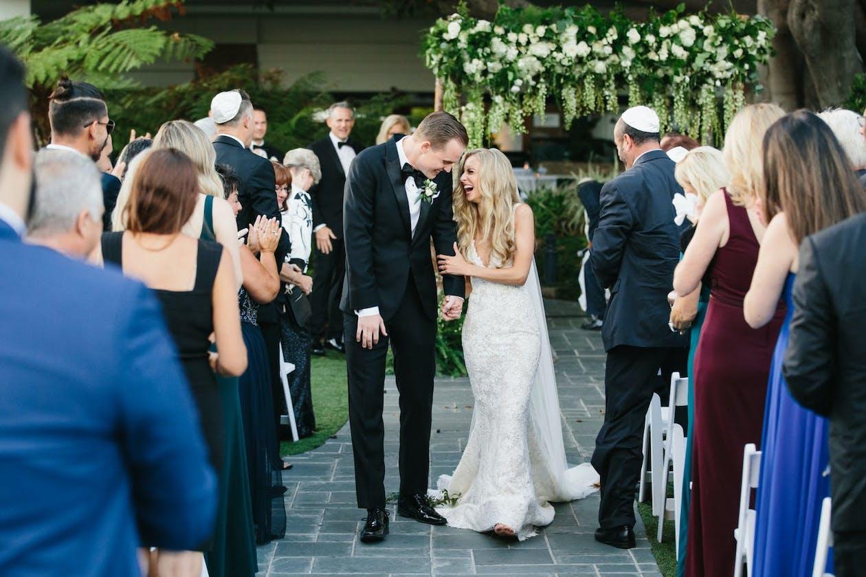 Wedding Recessional at Fairmont Miramar Hotel & Bungalows in Santa Monica, CA — an outdoor wedding venue in Los Angeles   PartySlate
