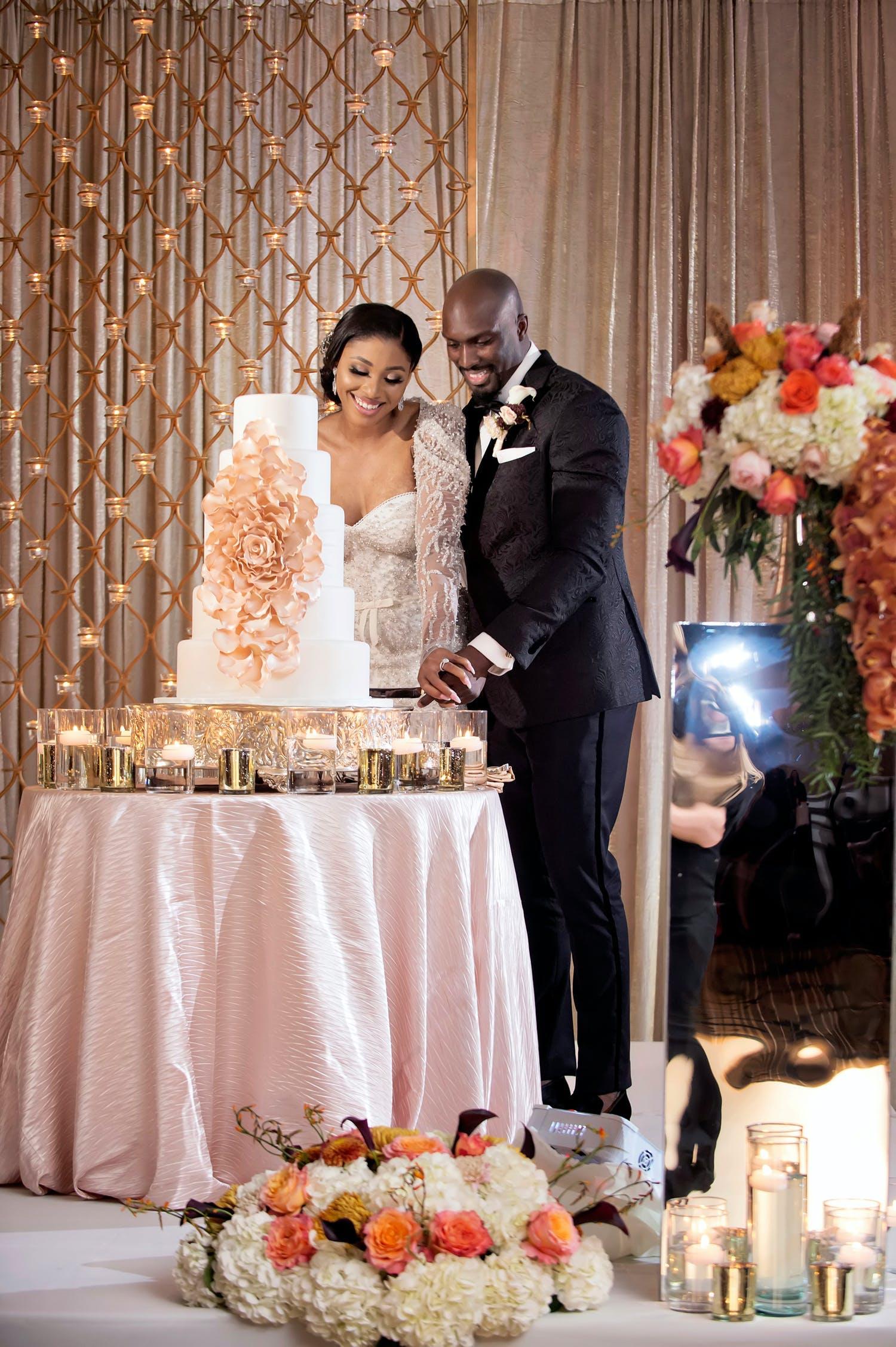 Bride and Groom Slice Cake at Glamorous Pink-Hued Wedding Reception at The Ritz-Carlton Atlanta   PartySlate