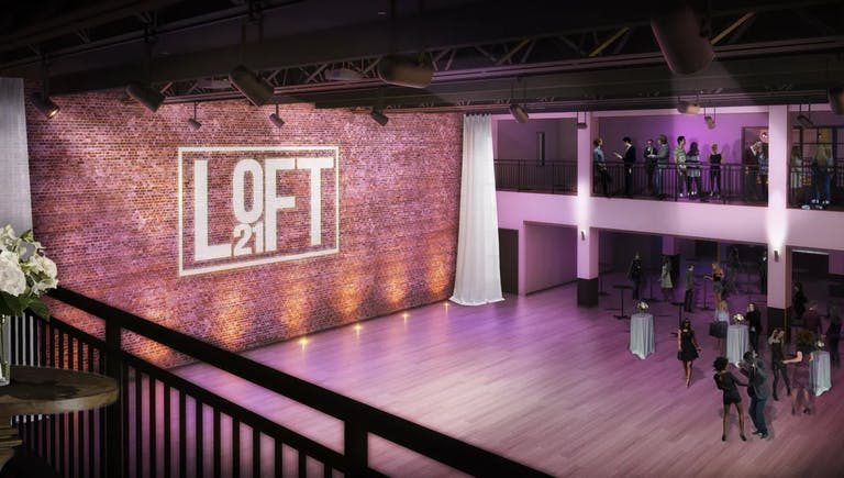 Indoor event venue space with purple uplighting at Loft 21 in Lincolnshire, IL | PartySlate
