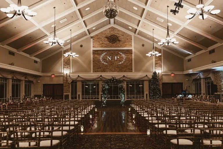 Simple wedding ceremony in barn-style venue with lofty ceilings at Chandler's Banquets in Schaumburg, IL | PartySlate