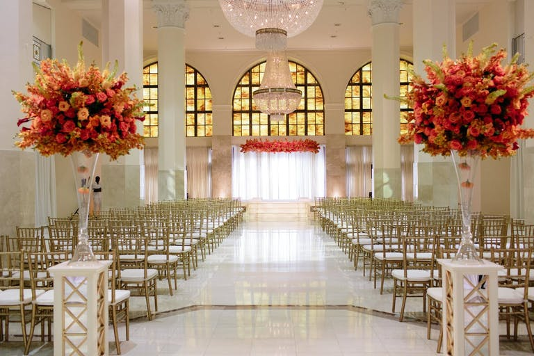 Opulent Wedding Ceremony With Bright Warm-Hued Florals in Southern Exchange Ballroom, one of Atlanta's Wedding Venues   PartySlate