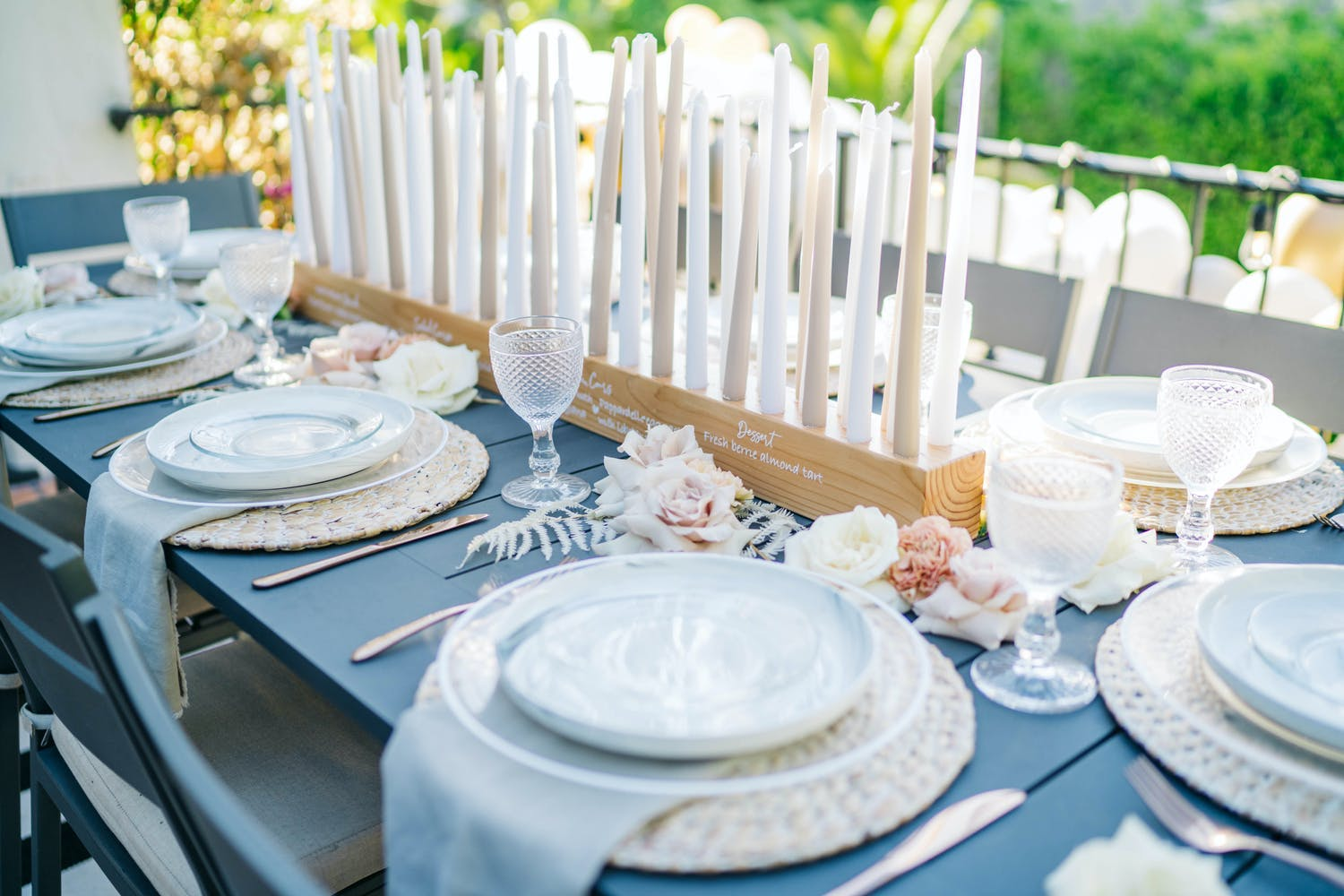 Tablescape with Custom Menu and Seating Chart Printed on Wooden Candle Holder with Pastel Candles for Birthday Party | PartySlate