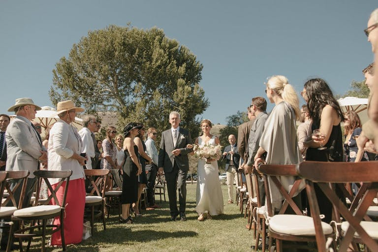 Bride and Groom Recessional Down the Aisle Outdoors at Catalina View Gardens in Rancho Palos Verdes, CA   PartySlate