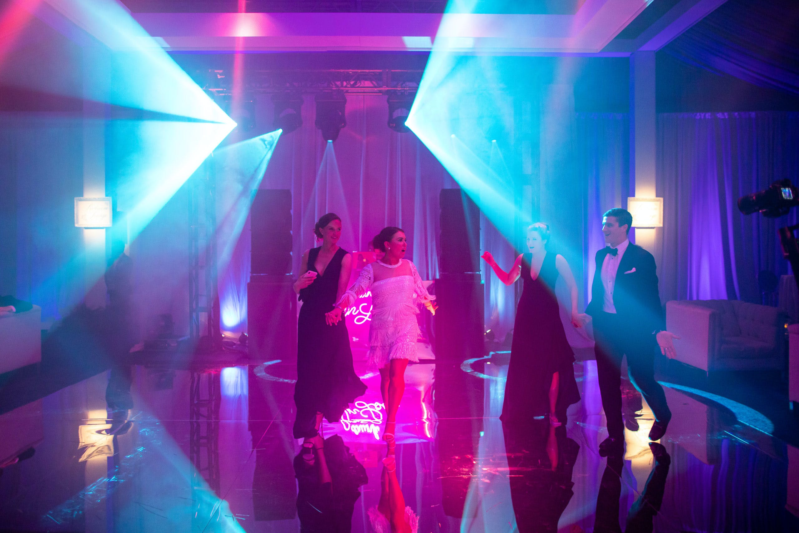dramatic blue and purple neon lighting at wedding after-party   PartySlate