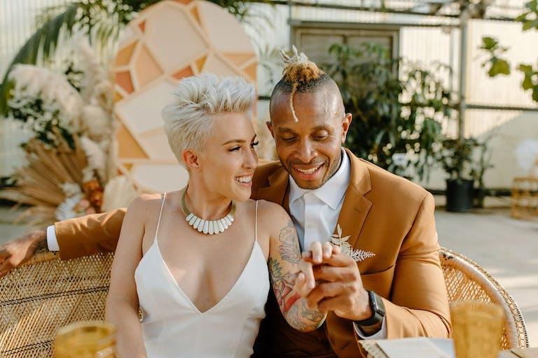 Bride and Groom Hold Hands at Outdoor Wedding at Plantenders Nursery in Silverado, CA   PartySlate