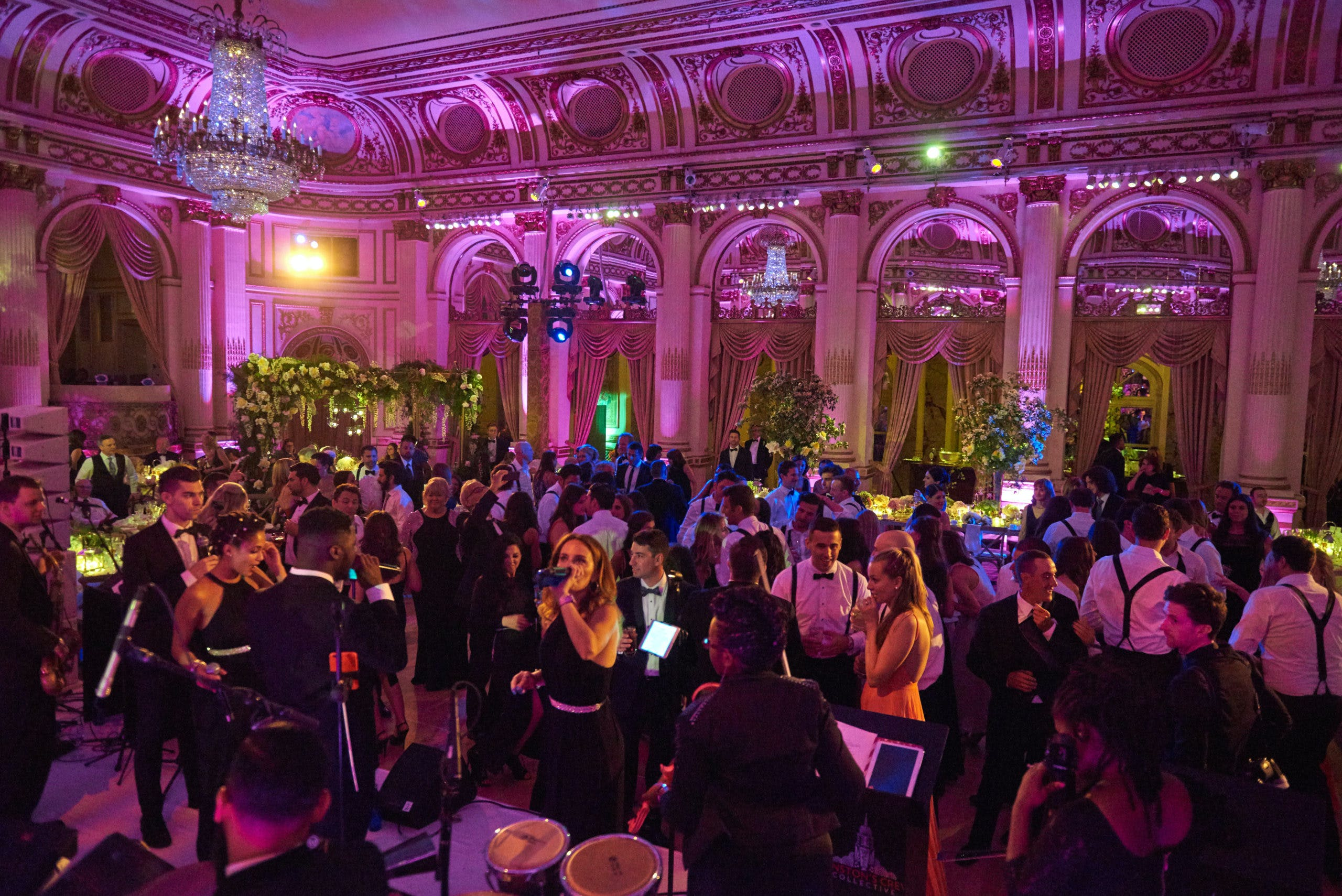 Reception venue filled with people on dance floor l PartySlate