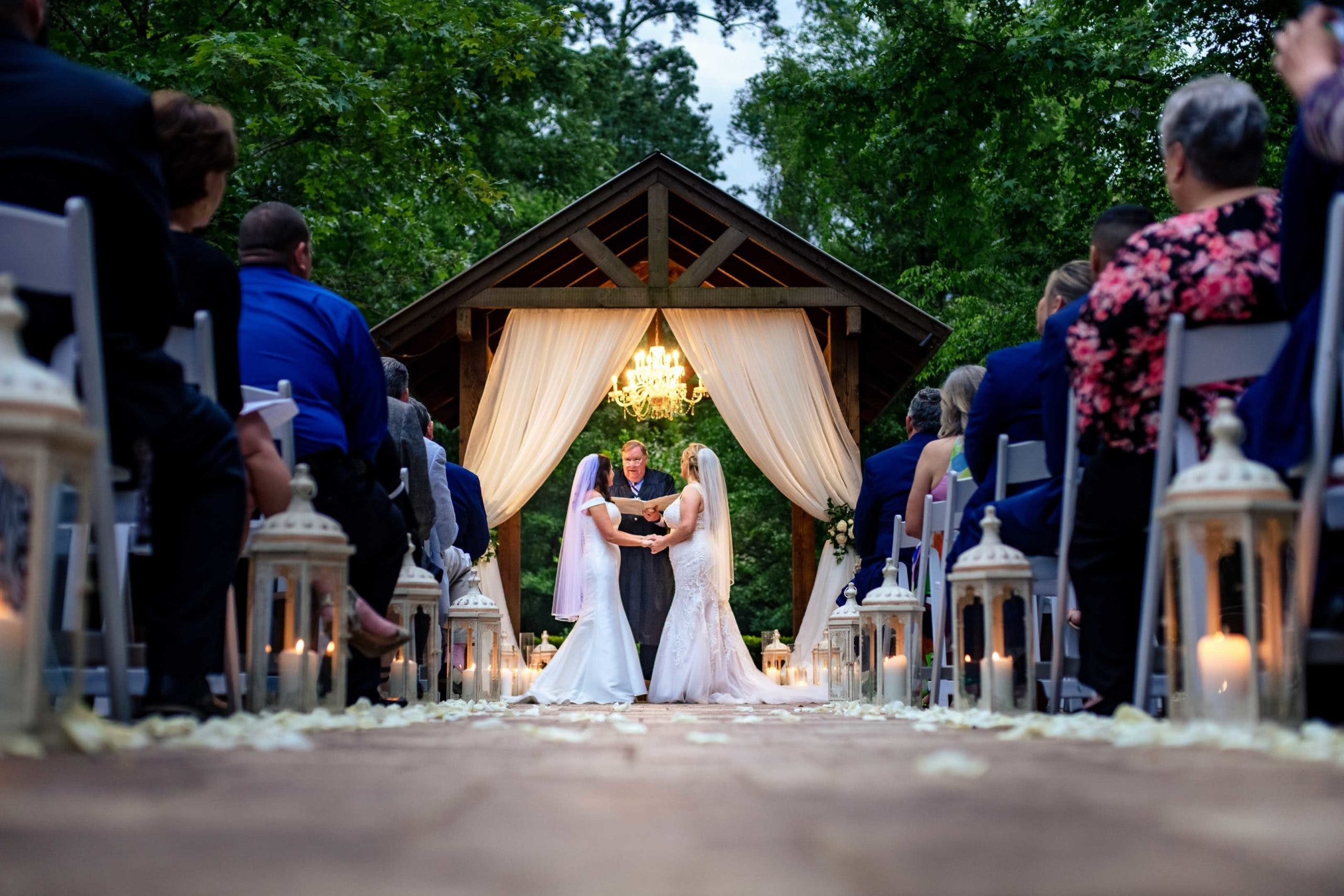 Two brides at end of aisle l PartySlate