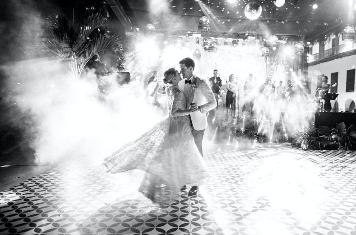 Black and white photo of bride and groom's first dance   PartySlate