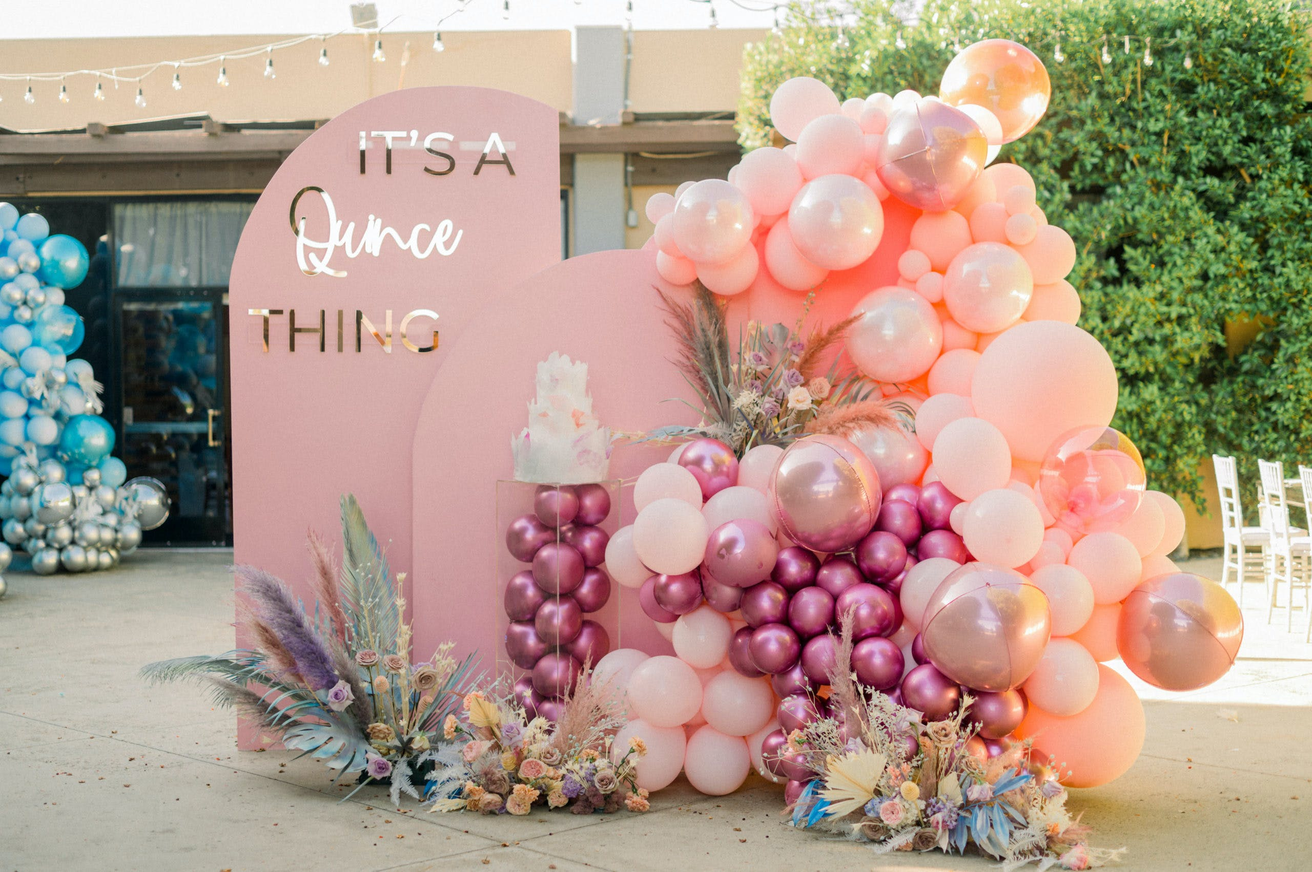 Pink Boho-Chic Backdrop With Magenta and Peach Balloons and Tie Dyed Pampas Grass for Quinceañera | PartySlate