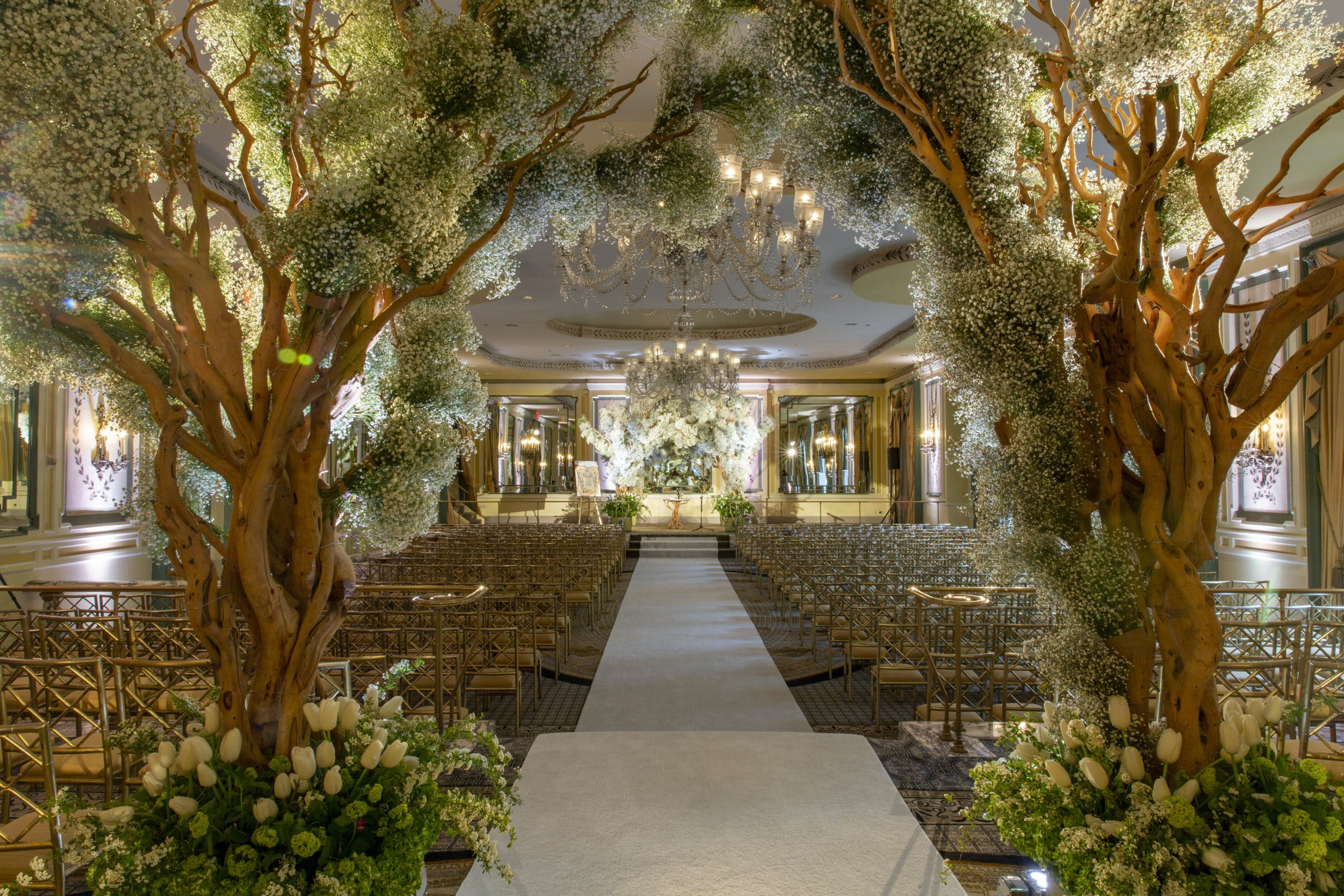 Greenery wedding aisle with two trees for entrance l PartySlate