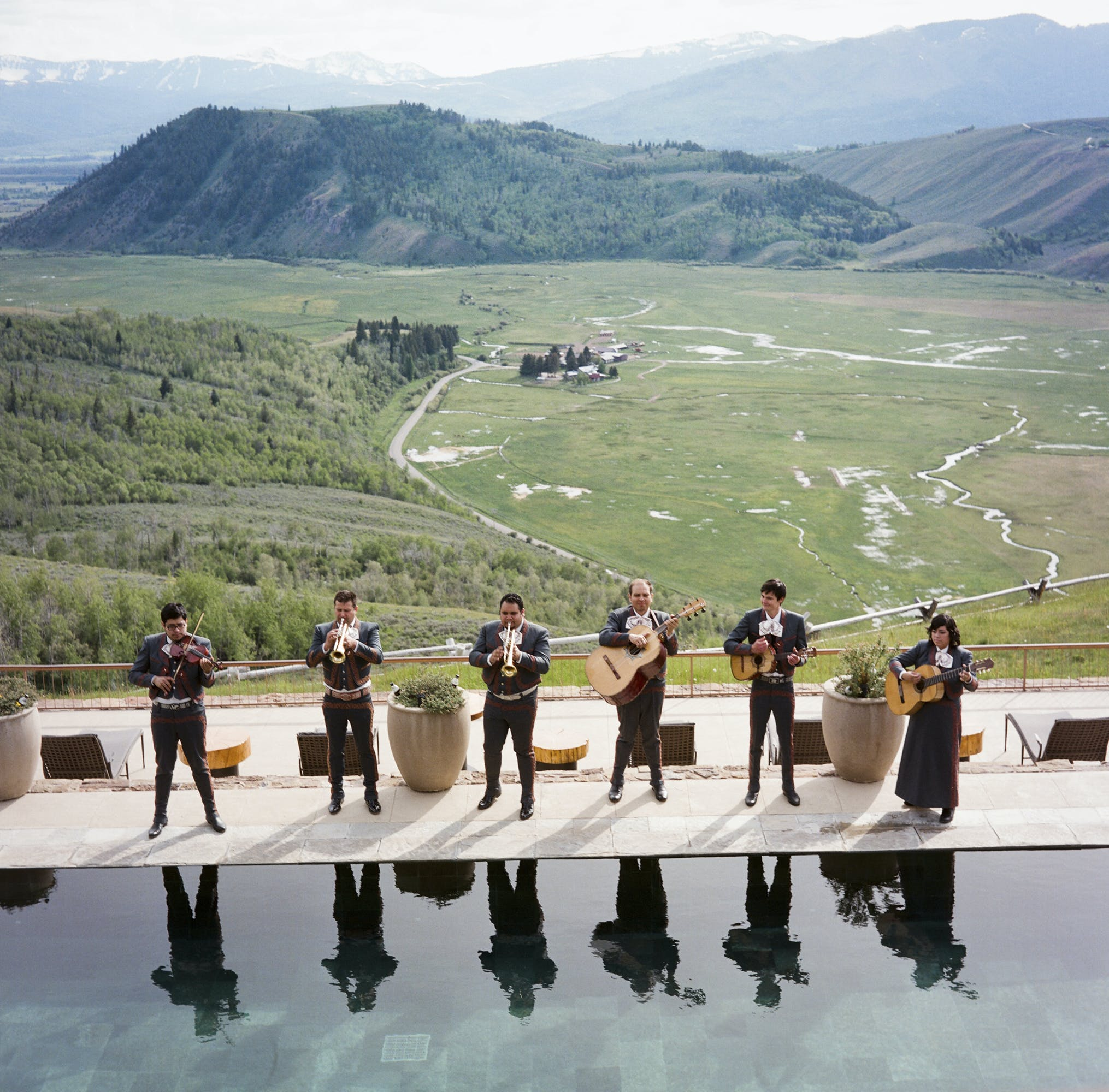 Band playing in front of scenic mountain view l PartySlate