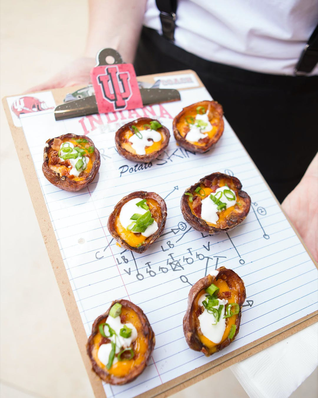 Passed bites served on clipboard with Indiana University Bloomington design for engagement party | PartySlate