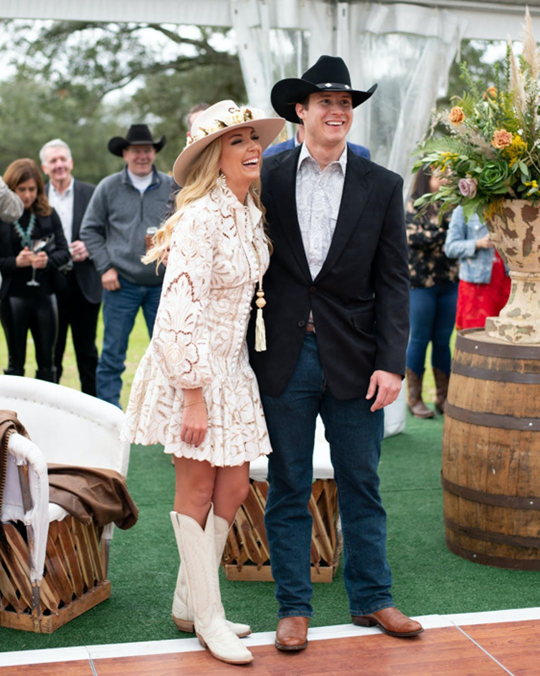 Couple poses in country outfits for country-themed engagement party | PartySlate
