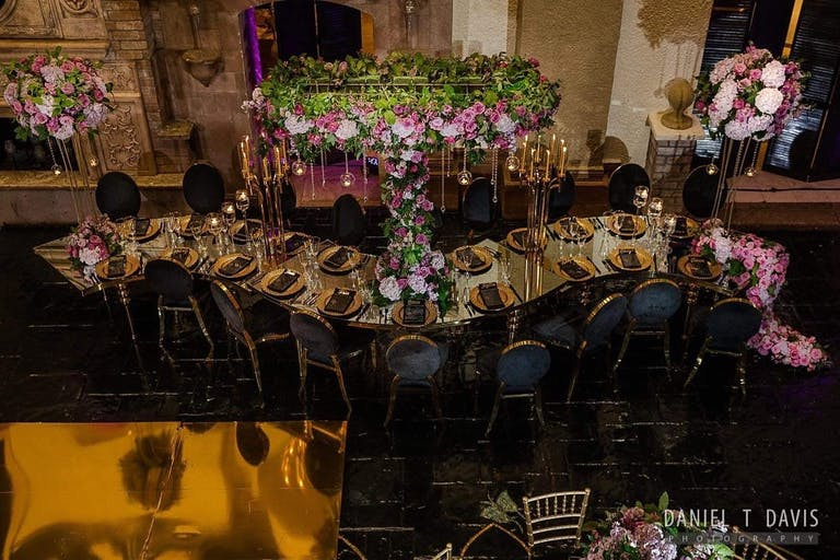 Glamorous and Modern Undulated Tablescape with Elevated Greenery and Purple Centerpieces by A Dream To Remember Events in Houston, TX   PartySlate