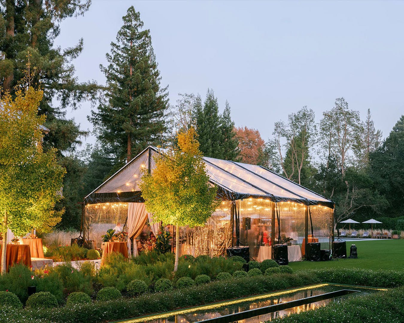 Transparent tent with autumnal lighting for engagement party | PartySlate