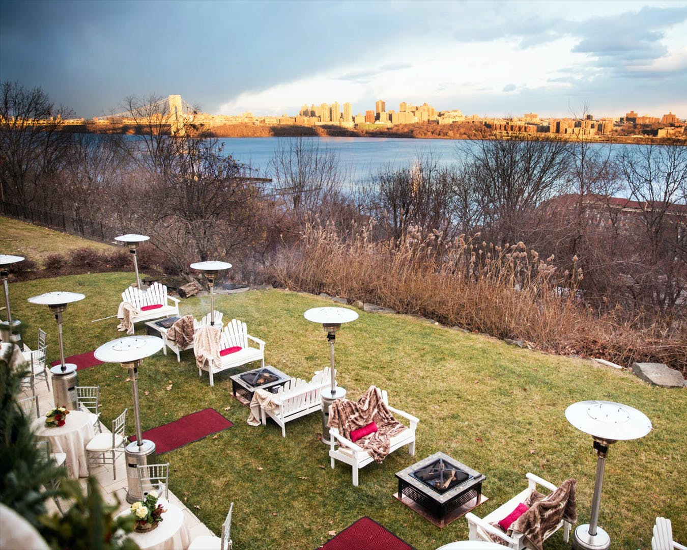 Outdoor lakeside winter engagement party with heaters | PartySlate