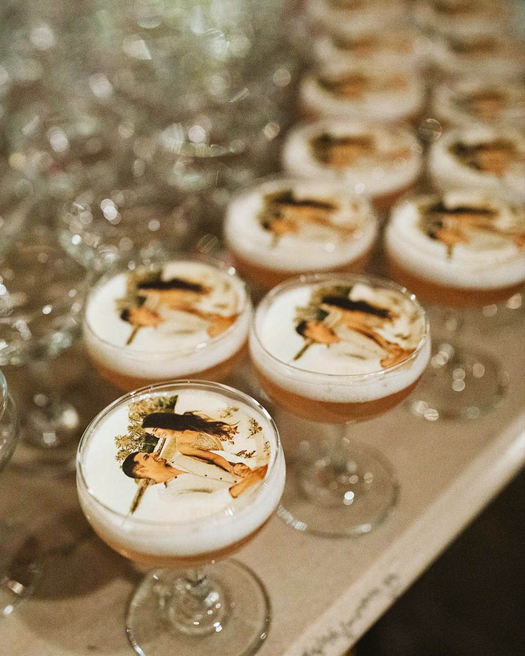 Cocktails with picture of engaged couple printed on foam | PartySlate