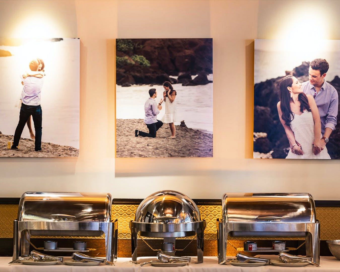 Photos from engagement shoot hung at later engagement party | PartySlate