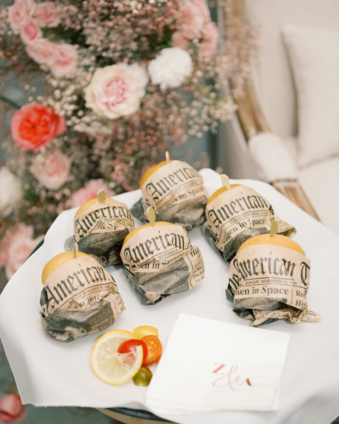 Newspaper-wrapped party sliders for engagement party | PartySlate