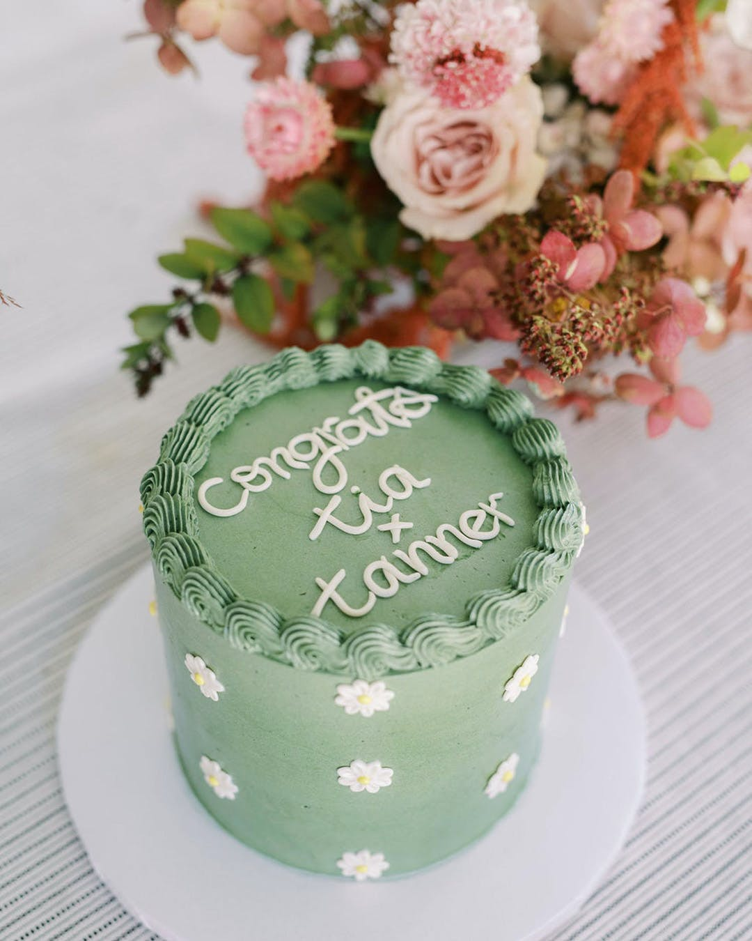 Green engagement party cake with white clouds down side | PartySlate