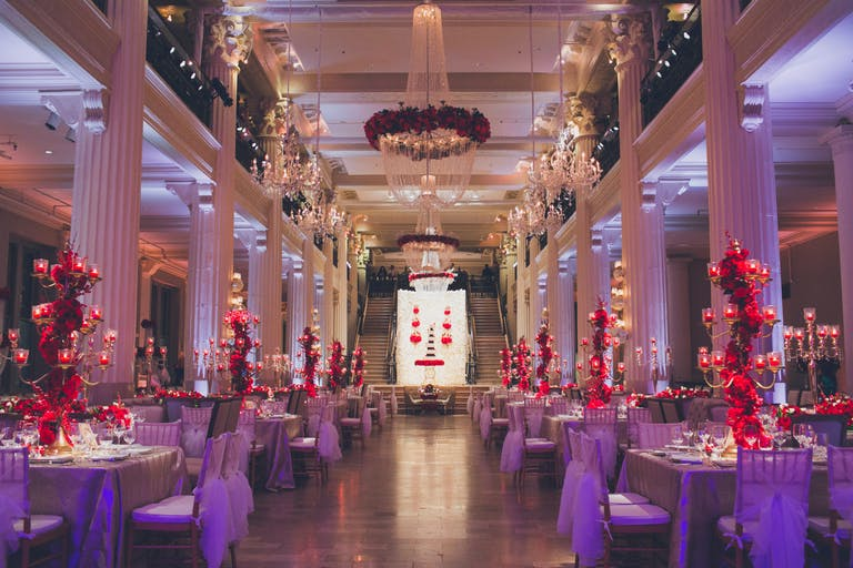 Glamorous Ballroom Celebration with Red Floral Décor and Glittery Chandeliers Planned by Elite Eventz of Houston, TX   PartySlate