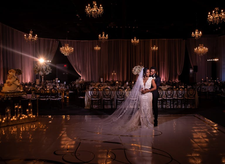 Bride and groom smile at each other at classic wedding planned by A Conceal Affair from Houston, TX   PartySlate