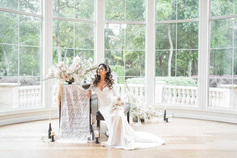 Bride with white and blush boho-style floral décor designed by EVENT by OVA   PartySlate