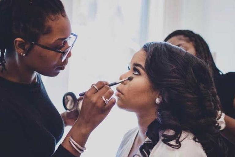 Tonia O Artistry puts makeup on a bride for her wedding day   PartySlate