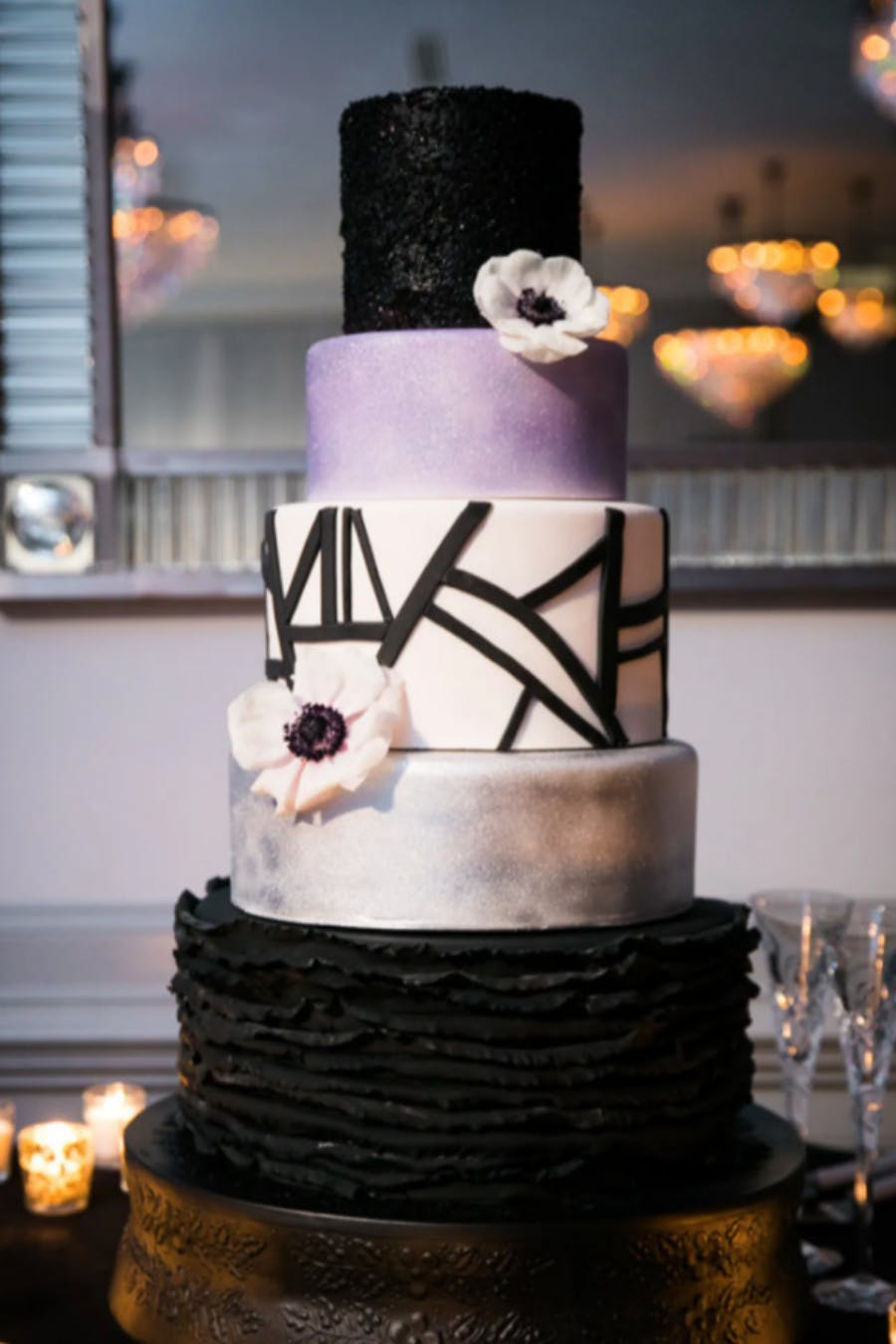 Modern Five-Tiered Wedding Cake in Purple, Black, and Silver | PartySlate